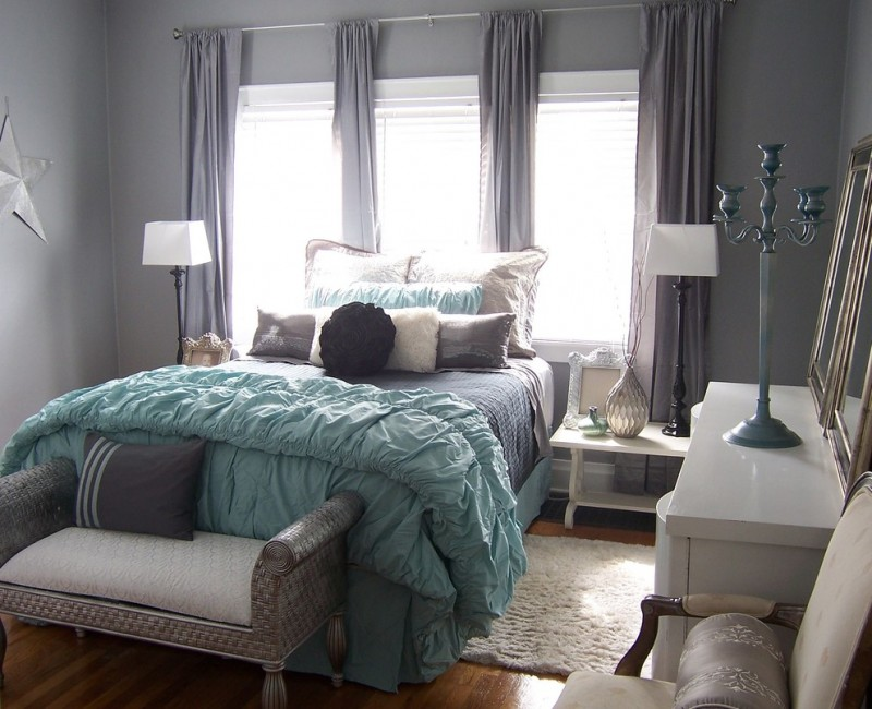 Contemporary teal and gray bedding with one love pillow in teal and five pillows and one rose pillow and fluffy teal covers