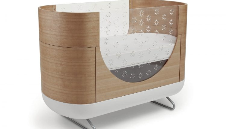 Oval brown wooden small baby crib
