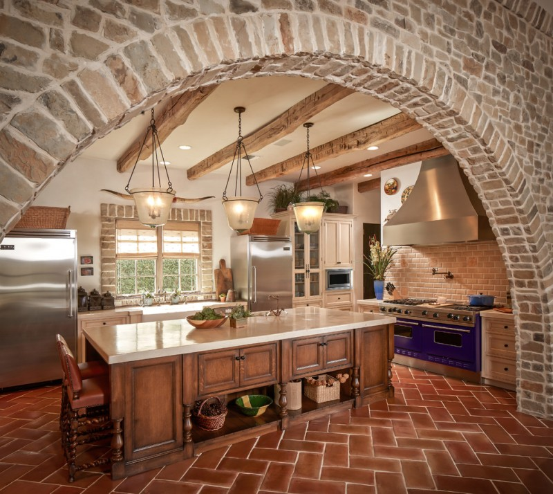 mediterranean kitchen design bricks hanging lamps window dining chair cabinet faucet sink terra cotta floor