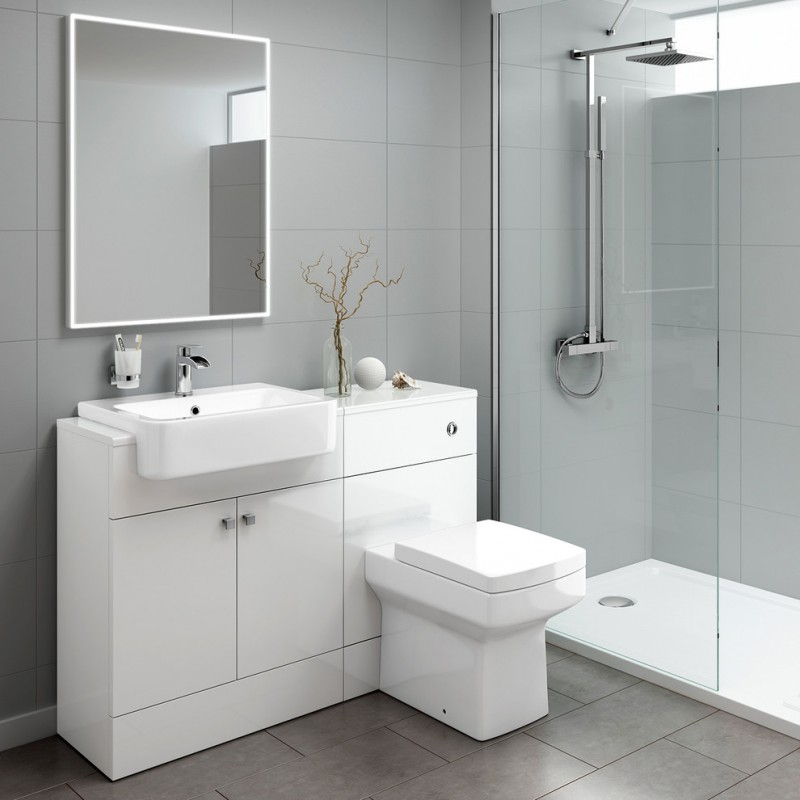 all in white high end plumbing fixtures with mirror, sink, toilet, shower