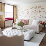 Beautiful Flower Wallpaper White Loveseat Decorative Pillows White Table White Rug Tiny Metal Side Table