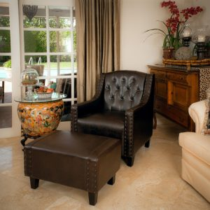 black brown leather club chair ottoman vase table flower cabinet chandelier cream curtain