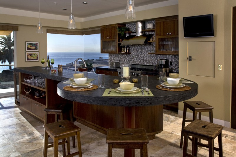 Hanging around the kitchen island decohoms for Kitchen island with round seating area