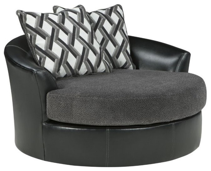 black round chair and a half with grey cushion and swuare pillows