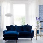 blue living room ideas blue sofa blue wall pattern blue flower pattern on floor big window white curtain
