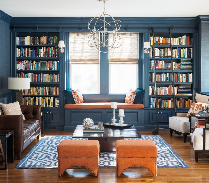 blue living room ideas blue walls bookshelves sofa carpet wood floor modern hanging lamp big windows
