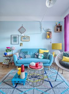 blue living room ideas carpet light blue sofa light blue wall small table wall storage curtain wood floor