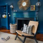 blue living room ideas carpet wood floor wall decoration chair pillow blue wall shoes basket storage