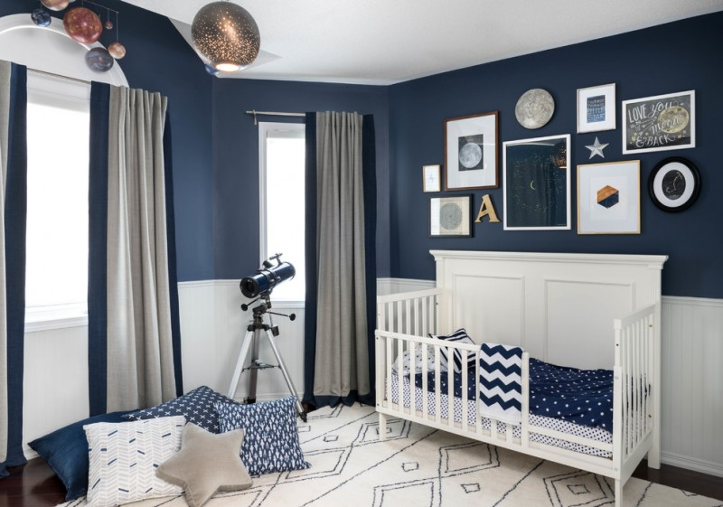 blue night sky color room with milkyway planet decoration, golden lamp, telescope, blu pillows, paintings, blue white theme cribs, an white rug, grey curtain