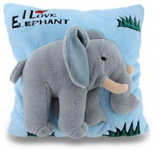 blue textured throw pillow with elephant doll sewed