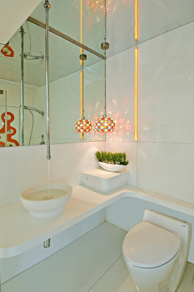 bright high end plumbing fixtures with white toilet, sink and colorful lamps