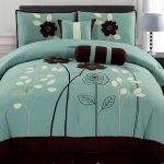 brown flower on teal bedding