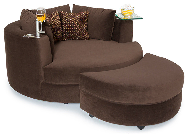 brown round a chair and half with glass tray holder in the left adn cupholder in the right and two accent pillows and ottoman
