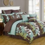 brown teal bedding and pillow with cream linen bed