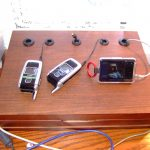 brown wooden table charging station