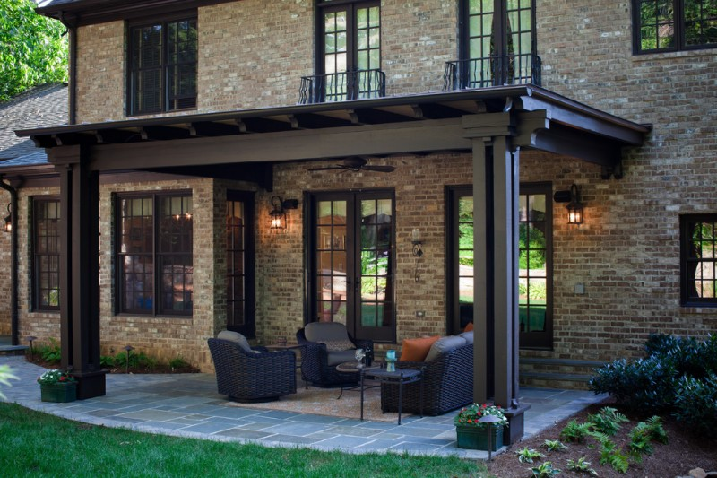 classic style brown brick wall dark wooden trim outdoor living room