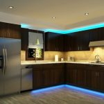 dark brown cabinet in kitchen with blue luminous LED lighting