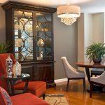 dark brown wooden high china cabinet with glass door and wooden door under