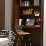 dark wooden closet space wire kitchen stool built  in desk hide a way door simple closet lights