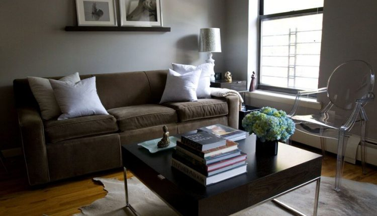 dusty brown sofa white decorative pillows modern hardwood coffee table leather carpet transparent chair hardwood flooring idea