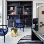 elegant contemporary office glass door glass top table shelves carpet blue surface chairs golden colored small table