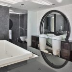 Elegant Spacious Bathroom Rectangular Modern Bathtub Circular Mirror Marble Patterned Wall Two Long  Standing Futuristic Washbasins