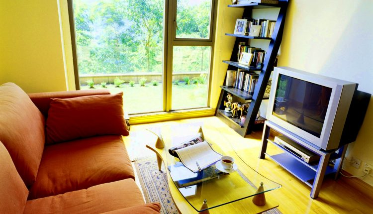 fully yellow wall idea orange loveseat glass top coffee table ottoman mat black ladder bookshelf modern TV table with shelves