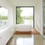 glass wall reflecting mirror wall undermount sink modern white cabinet free standing oval bathtub
