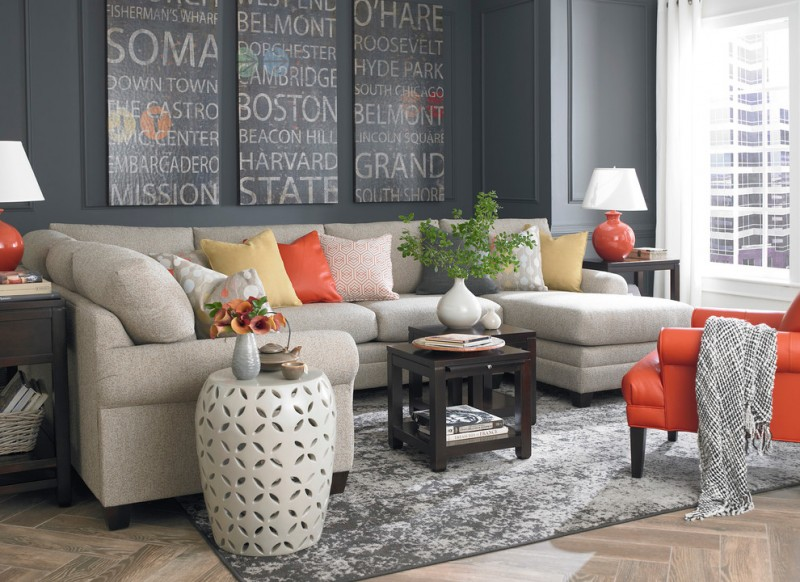 grayish brown small sectional sofa with colorful pillows