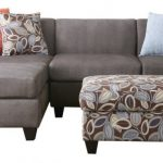 grey sectional sofa with chic pillows and floral print ottoman