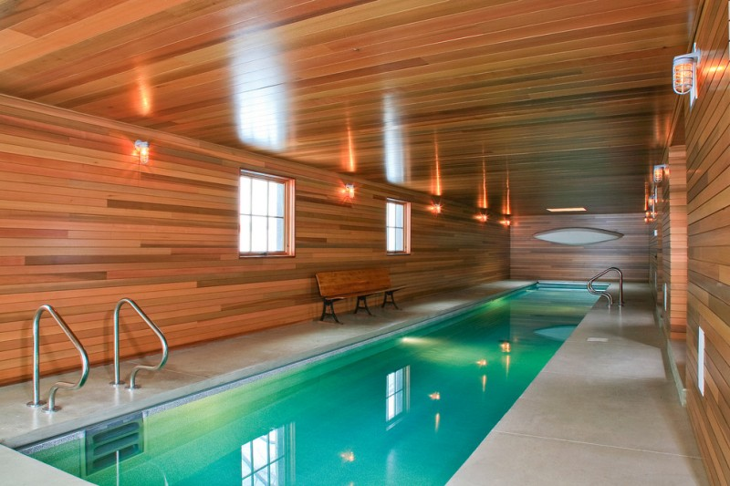 indoor lap pool modern lights long pool poolside bench wooden walls wooden ceiling