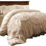 ivory bedding set with flower lace as accents on comforter and pillows