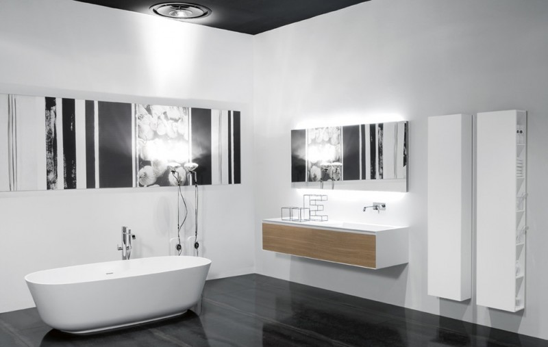 large white and brown high end plumbing fixtures with tub, shower, sink, mirror, decoration