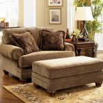 light brown one and a half chair with ottoman