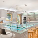Light Gray Kitchen Cabinets Wooden Dining Chairs Glass Top Modern Kitchen Lamps Drawer Faucet Sink Big Window