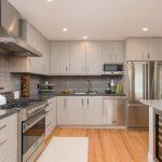 Light Gray Kitchen Cabinets Wooden Floor Ceiling Lamp Stove Faucet Sink Wall Cabinet Metalic Door