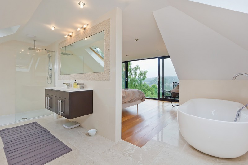 modern bathroom long lights bathtub wooden floor modern wall white ceiling cabinets glass door mirror