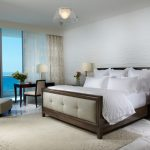 modern bedroom carpet elegant bed bedroom cabinet cute light glass door small table curtains white ceiling