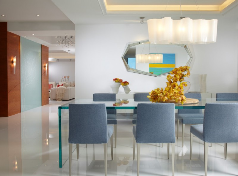 modern dining room light blue chairs glass table shiny floor mirror flowers sofa chandelier modern lamps white ceiling