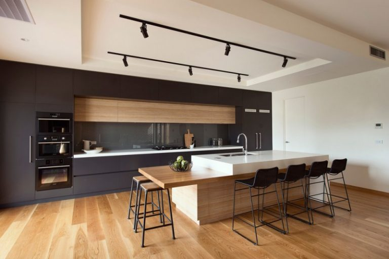 Modern Kitchen Tall Chairs Wooden Floor White Walls Modern Lamps Cabinets  Modern Stove Elegant Countertop