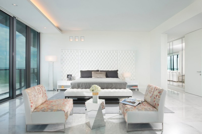 modern master bedroom glass door sofa modern lights white ceiling white walls white floor flowers modern table