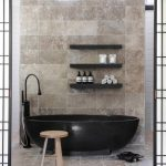 Modern Oval Dark Free Standing Bathtub Floating Customized Shelves Patterned Marble Tiles Of Wall Sliding Doors Simple Elegant Shower