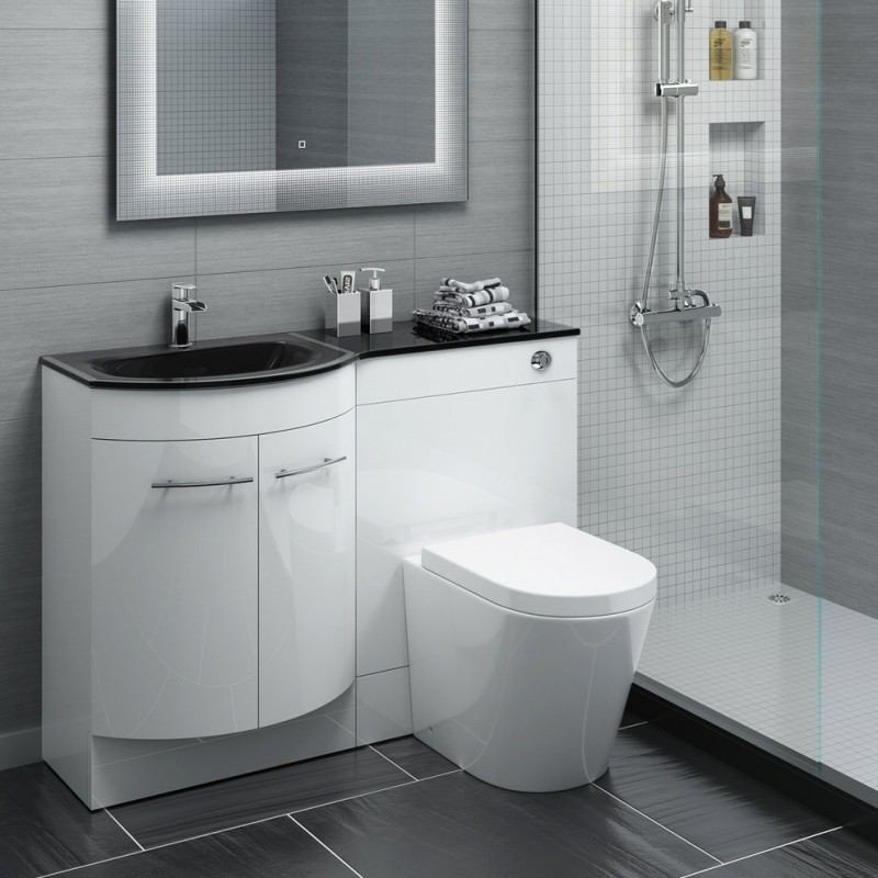 modern white high end plumbing fixtures with sink, toilet, mirror, shower, shampoo soap storage