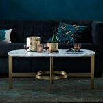ovale marmer iron coffe table with blak couch and blue cushion