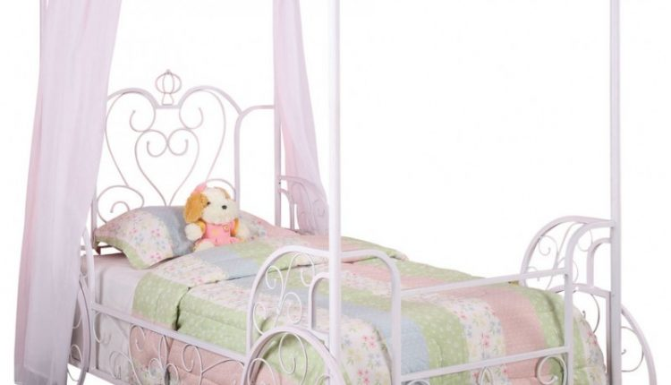 pink white carriage framed bed with curtain