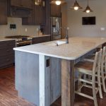 Polished Countertop And Wooden Legs Kitchen Islands With Seating For 4