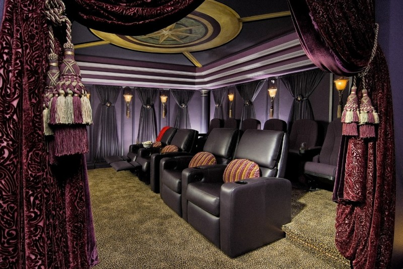 purple motif curtains home theater black chairs brown carpet strips cushions black curtains lamps