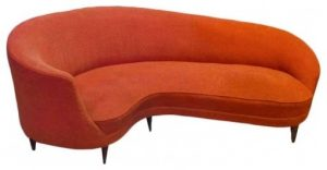 red orange small curved sofa