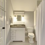 small bathroom remodel ideas black and white tiles curtain door towel rack faucet sink mirror toilet