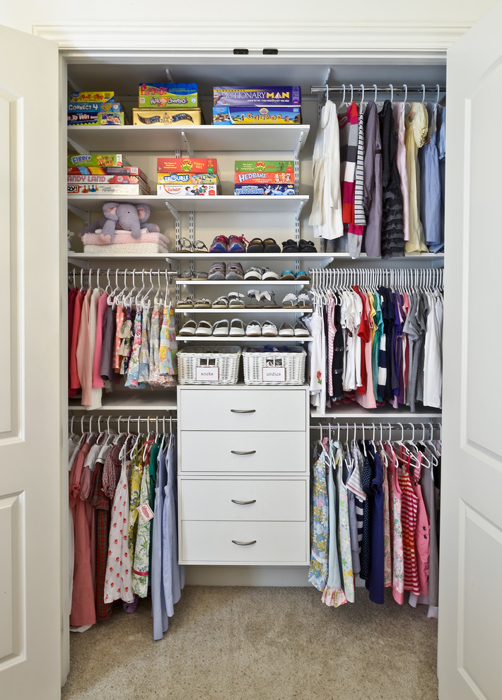 small closet for children with baskets drawers and hanging place